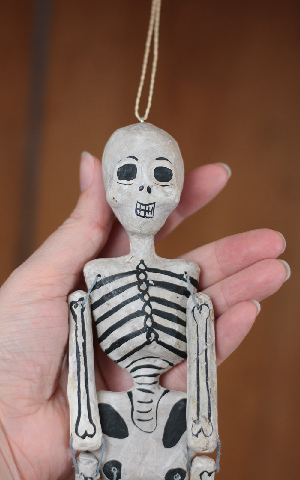 female recycled paper skeleton ornament  by cody foster