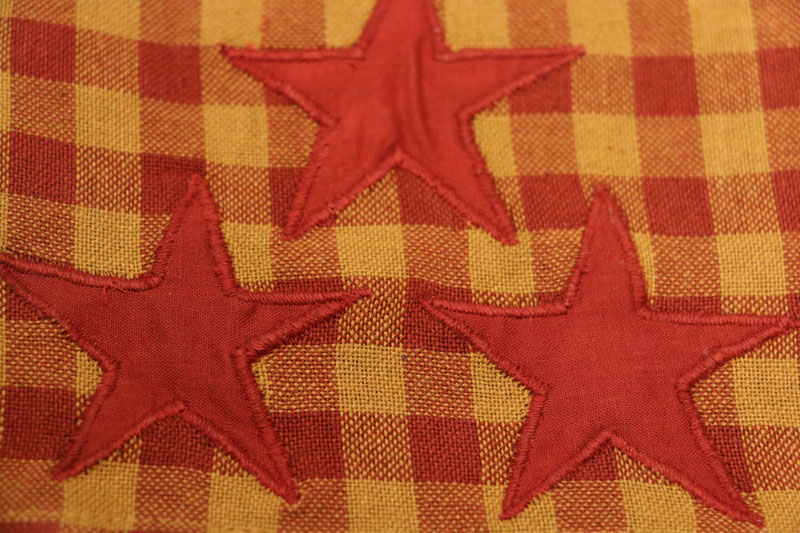 burgundy check fabric detail with appliqued star
