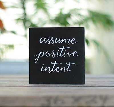 Assume Positive Intent Shelf Sitter Sign