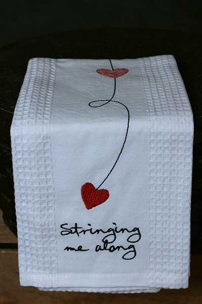 Stringing Me Along Embroidered Waffle Weave Kitchen Towel