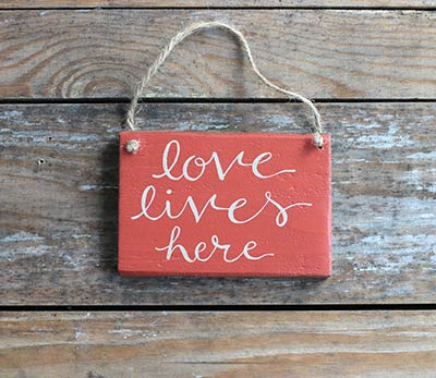 Love Lives Here Wooden Sign