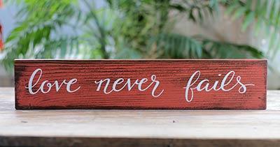 Love Never Fails Wood Sign (Custom Colors Available)
