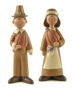 Pilgrims Holding Pumpkins (Set of 2)