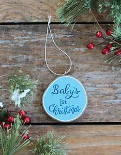 Our Backyard Studio Baby's First Christmas Wood Slice Ornament - Blue (Personalized)
