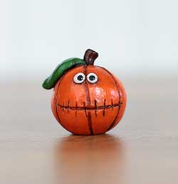 Orange Jack o'Lantern with Leaf and Stitched Smile