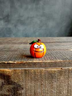 Orange Jack o'Lantern with Leaf - Mischief