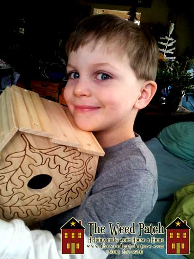 Ben with is finished unpainted birdhouse