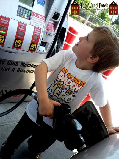 Ben helping pump gas, for the first time ever