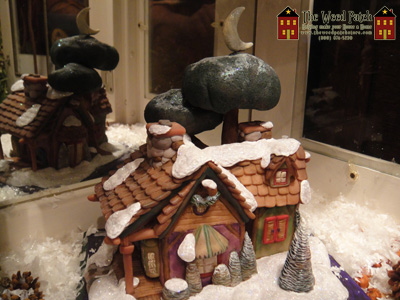 Santa Sculptor Dennis Brown Christmas Cottage
