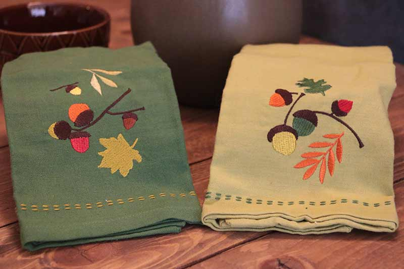 Split Pea Green Acorn Embroidered Guest Towel, by Tag.