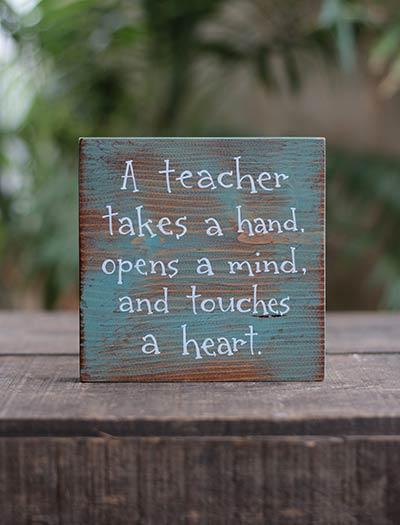 A Teacher Takes a Hand Shelf Sitter Sign