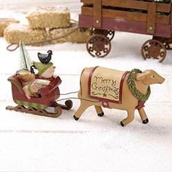 Cow with Wreath Pulling Animal Sleigh