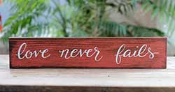 Love Never Fails Wood Sign (Custom Colors Available)
